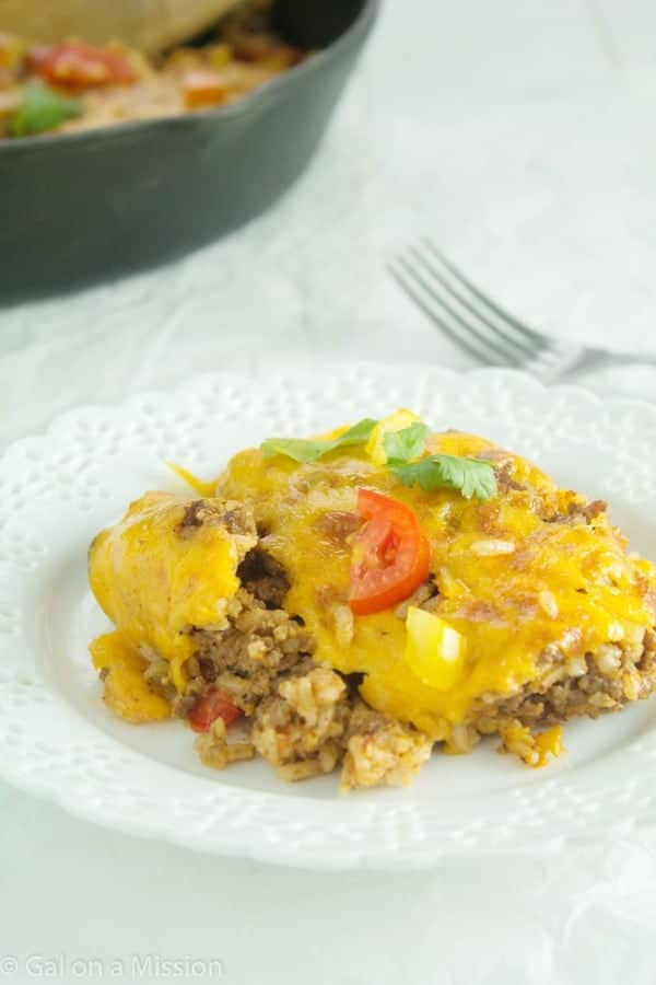 A delicious cheesy beefy rice casserole that is perfect for a busy weeknight meal! Everyone will be satisfied!