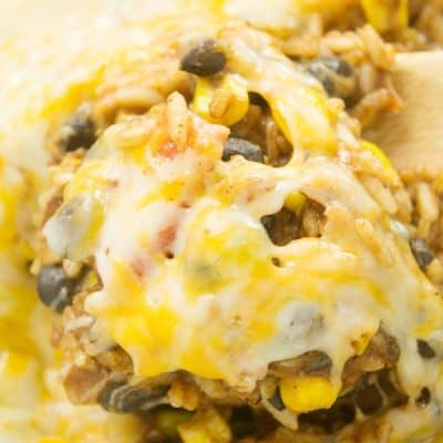 A delicious cheesy enchilada rice skillet casserole recipe, perfect for an easy weeknight meal. Ready under 20 minutes!