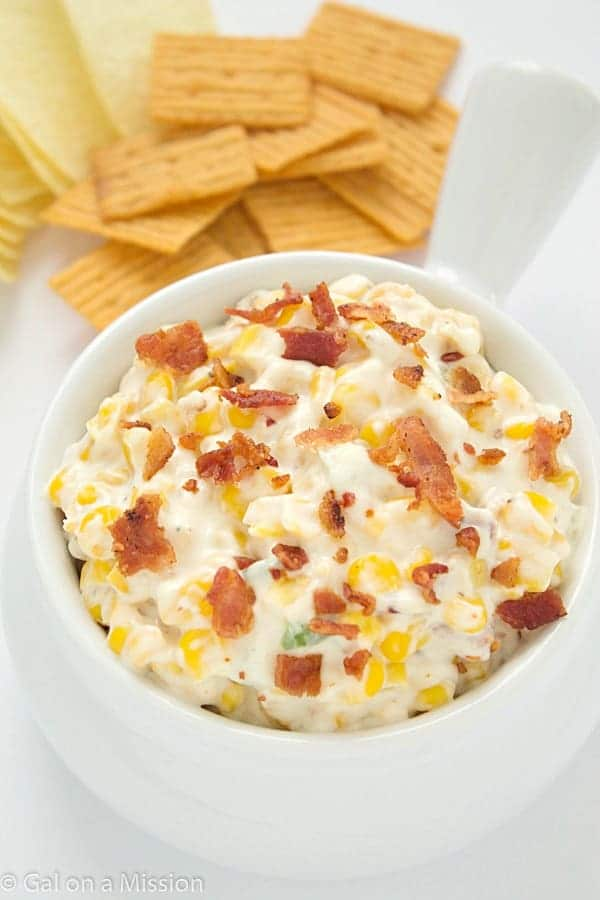 An out-of-this-world delicious and very addicting slow cooker spicy corn dip recipe! Great for the big games!