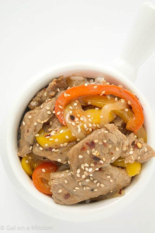 A delicious spicy sesame beef stir fry recipe that can be made in 30 minutes! Loaded with tons of fresh bell peppers and onions.