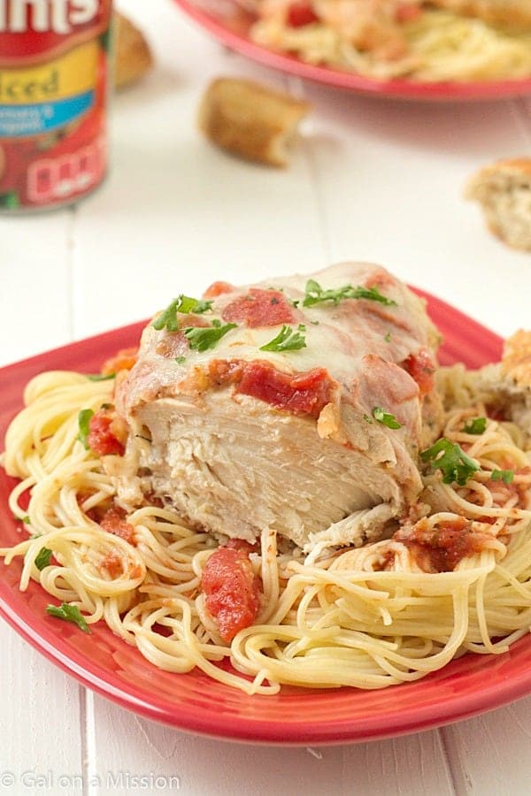 Easy Chicken Parmesan: Moist and juicy chicken breasts coasted in breadcrumbs, mixed with Italian seasonings; then topped with diced tomatoes, Parmesan cheese, and fresh mozzarella.