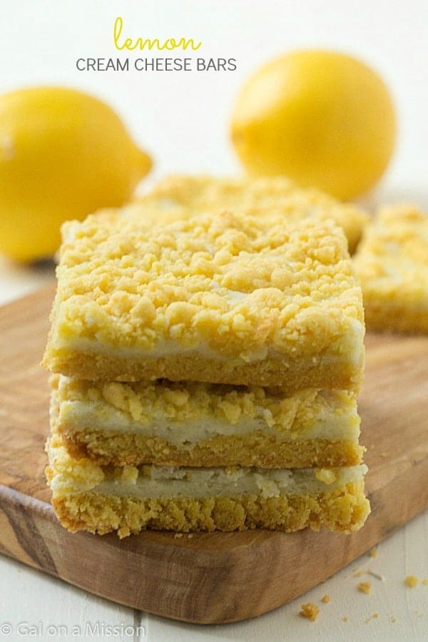 Lemon cream cheese bars: Decadent lemon whipped cream cheese baked between layers of a special ingredient with a delicious streusel lemon topping. A simple and quick dessert bar recipe!