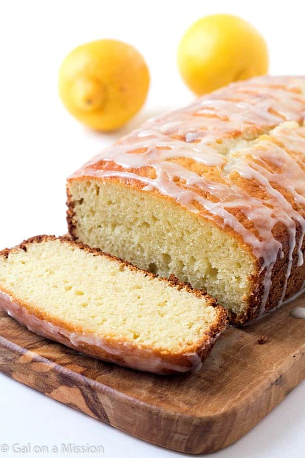 Lemon Yogurt Cake Recipe - Incredibly moist and tender. One bite and it melts-in-your-mouth and you can say it's finger-licking delicious, too! Everyone all ages loves a lemon cake with lemon icing!