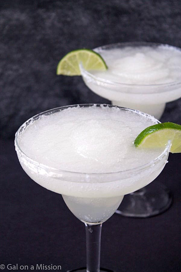 Frozen Margaritas - We all love frozen margarita recipes on a hot summer day! Skip the store-bought mixes and make your own! So much better and absolutely refreshing! If you are looking for frozen margaritas for a crowd, then simply double or triple the recipe!