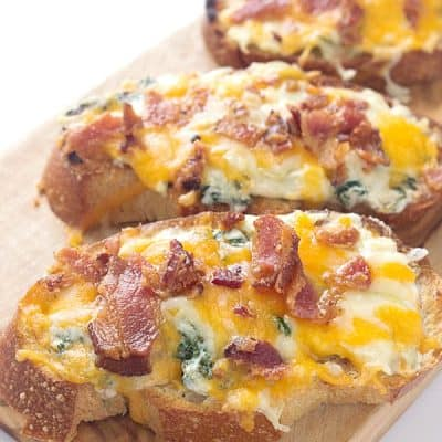 Cheesy Bacon, Kale, Artichoke Crostini