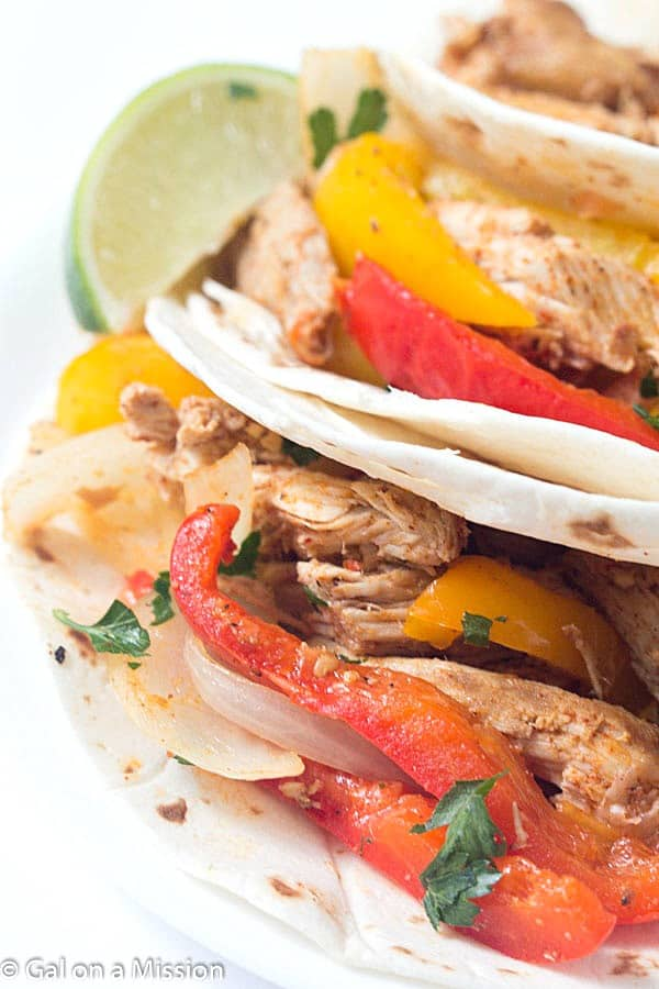 Crock-Pot Pulled Pork Fajitas - Tender pork, shredded and then cooked with a variety of bell peppers and onions! The perfect weeknight or weekend meal!
