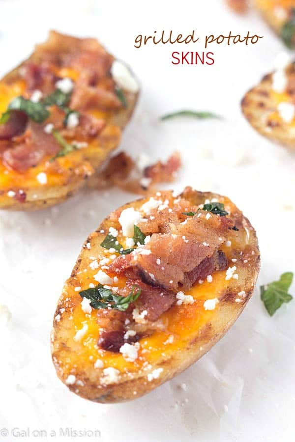 Grilled Potato Skins – The ultimate comfort food! Made with my new favorite Nikos Feta Cheese. Every bite contains a zesty, savory, and slightly tangy flavor!