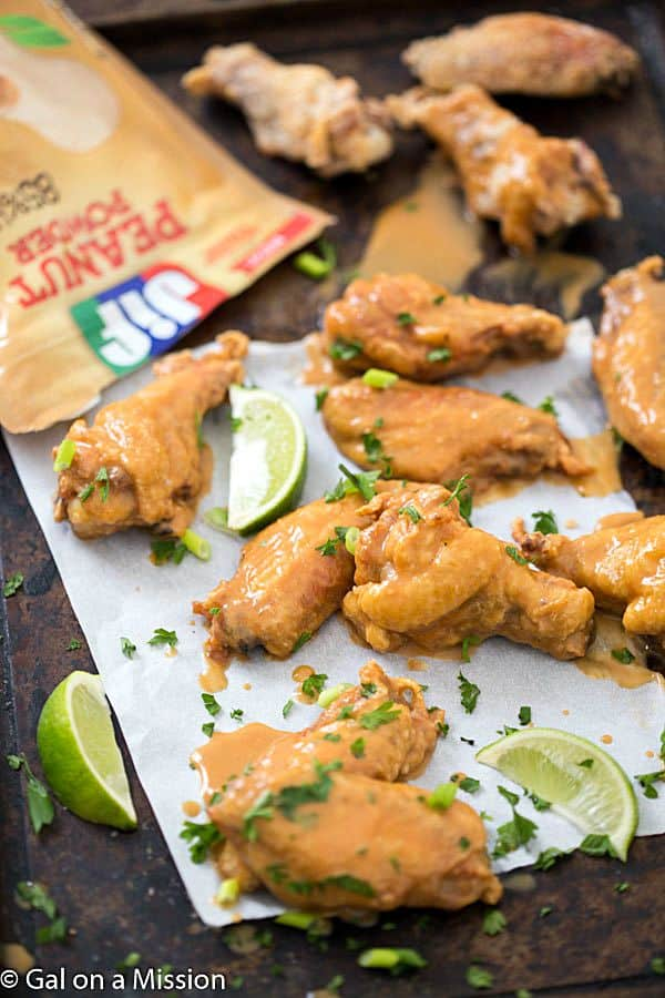 Crispy Baked Chicken Wings with Peanut Sauce - Crispy, crunchy exterior and tender interior. Topped with an out-of-this-world peanut sauce!