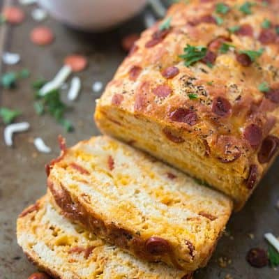 Pepperoni Pizza Quick Bread - Moist and flavored with cheddar cheese and mini pepperonis! Don't forget the marinara sauce!