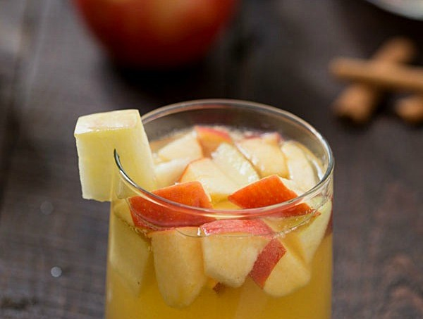 Apple Sangria - The perfect cocktail for busy holidays to relax with friends and family. Hints of honey crisp apples, caramel, apple cider, and cinnamon!