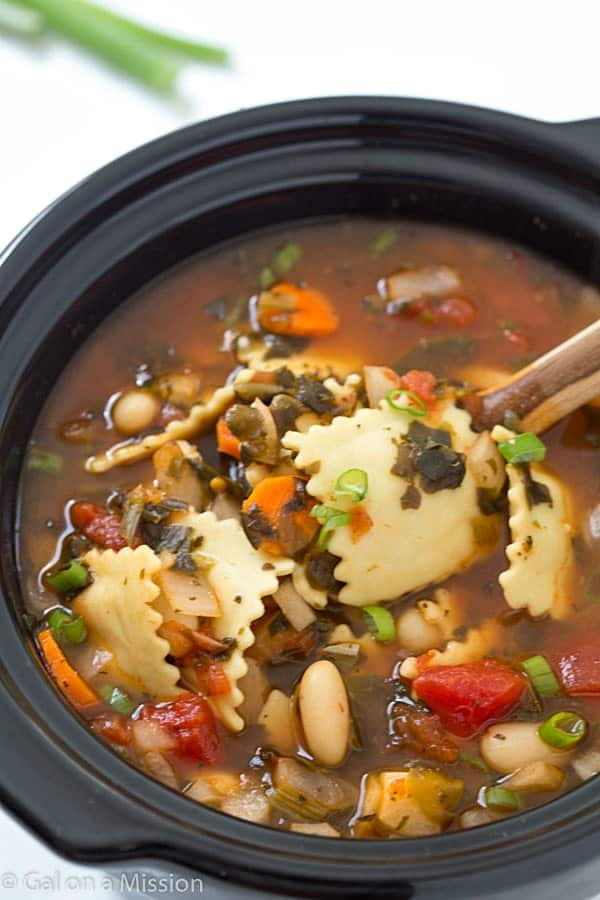 Slow Cooker Ravioli Soup - Loaded with vegetables, cheese-stuffed ravioli! So good, grab a piece of bread and let's dig in!