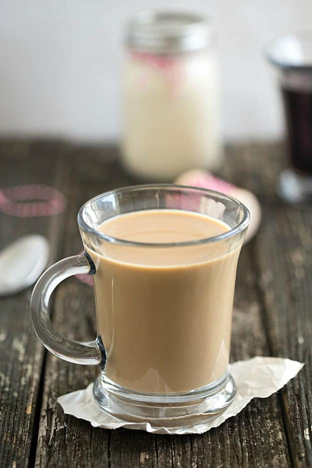 Homemade Eggnog Coffee Creamer - Incredibly easy with only three ingredients. Great for homemade gifts! Enjoy a piece of eggnog cheesecake or even an eggnog cookie on the side!