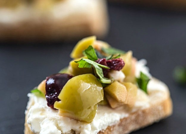 Mixed Olive and Whipped Feta Crostini - An incredibly easy appetizer that will wow your party guests!