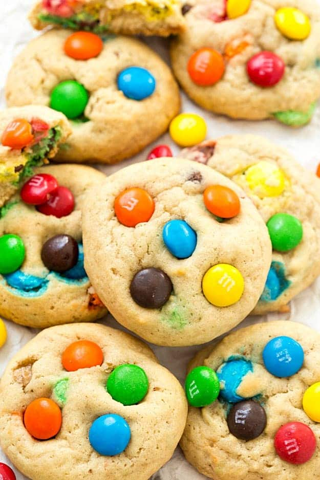M&M's Cookies - Soft-baked and chewy bakery cookies at home! So easy to make and perfect for parties or any festivities! Everyone loves cookie recipes, especially colorful ones!
