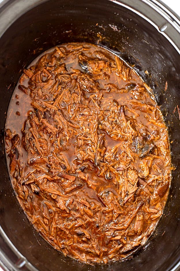 4-Ingredient Slow Cooker Dr. Pepper Pulled Pork - So easy with only five minutes or prep for the most delicious shredded pork! This recipe is ridiculously easy, the ultimate set and forget slow cooker recipe. The leftovers are perfect for tacos, sandwiches, nachos, to name a few of the obvious ones!