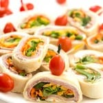 """Ham and Veggie Pinwheels - Layered with black forest ham, shredded carrots, sliced green peppers, and topped with romaine lettuce. Perfect as appetizers for a party or a delicious and healthy lunch! These adorable bite-sized little """"sandwiches"""" are so good!"""