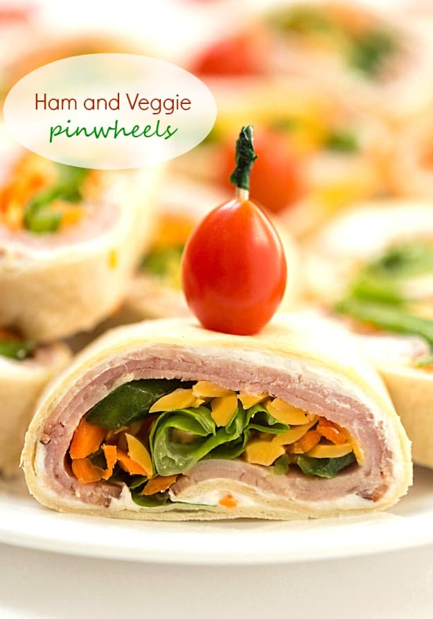 "Ham and Veggie Pinwheels - Layered with black forest ham, shredded carrots, sliced green peppers, and topped with romaine lettuce. Perfect as appetizers for a party or a delicious and healthy lunch! These adorable bite-sized little ""sandwiches"" are so good!"