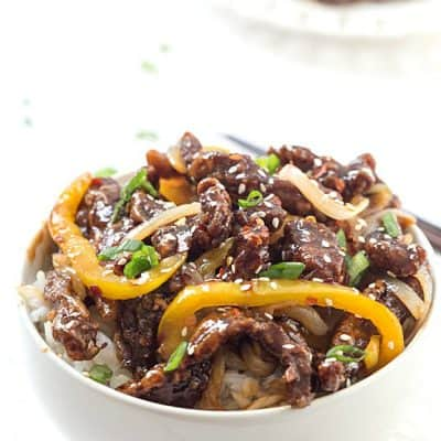 Crispy Spicy Sesame Beef Recipe - Tender and crispy beef stir-fry made with real pantry ingredients! Skip the take-out and made this instead! Add an extra cup of broccoli to make your favorite take-out dish at home!