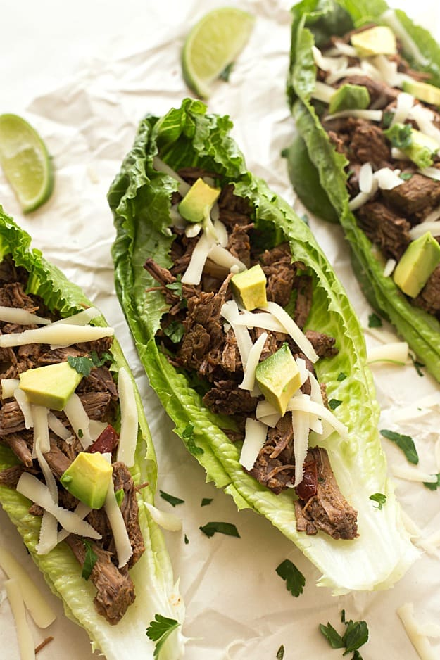 Slow Cooker Barbacoa Taco Lettuce Wraps - Takes 5 minutes to prep in the crockpot and creates the most tender and juiciest homemade barbacoa! Flavored with the traditional barbacoa flavors: garlic, oregano, cumin; including chipotles in adobo! The not historically known authentic recipe, but oh, so delicious! Takes no time to assemble these lettuce wraps. Perfect for a lighter and low-carb option!