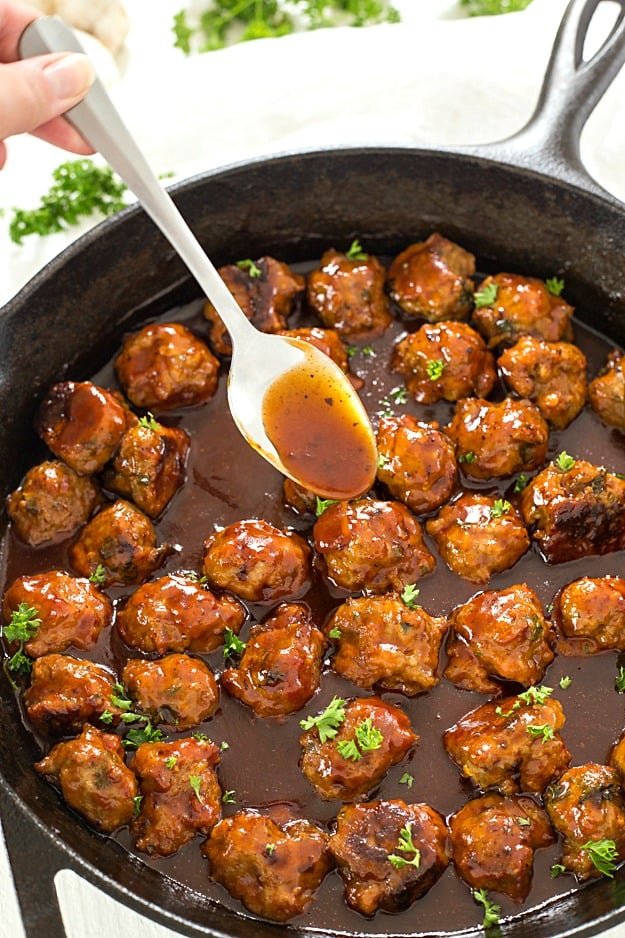 Bacon Honey Bourbon Chicken Meatballs - These meatballs are so easy and bake to perfection, and then simmer in an out-of-this-world honey bourbon barbecue sauce! Perfect as an appetizer or to serve on sandwiches!
