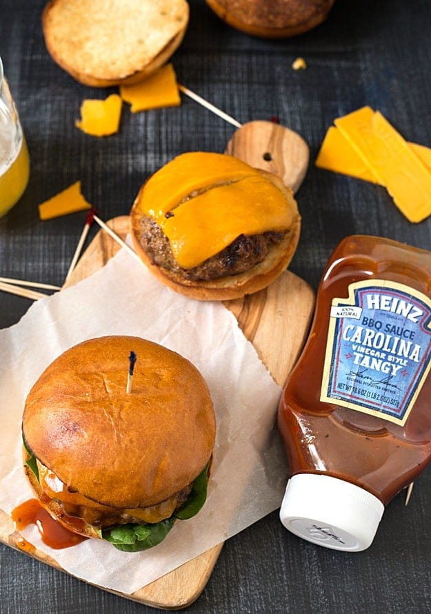 Carolina-Style Angus Beef Burger - Not your average burger! Juicy beef burgers are carefully seasoned with a tangy vinegar-based BBQ sauce and spices and finished with even more lip-smacking, finger-licking BBQ sauce!