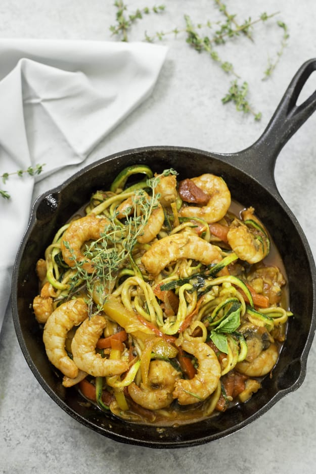 Italian Shrimp and Zucchini Noodles (Zoodles) - A delicious and healthy meal made with spiralized zucchini noodles, bell peppers, fresh spices, shrimp, and tossed with a thick and hearty pasta sauce! Super easy to make and perfect for a quick weeknight meal.