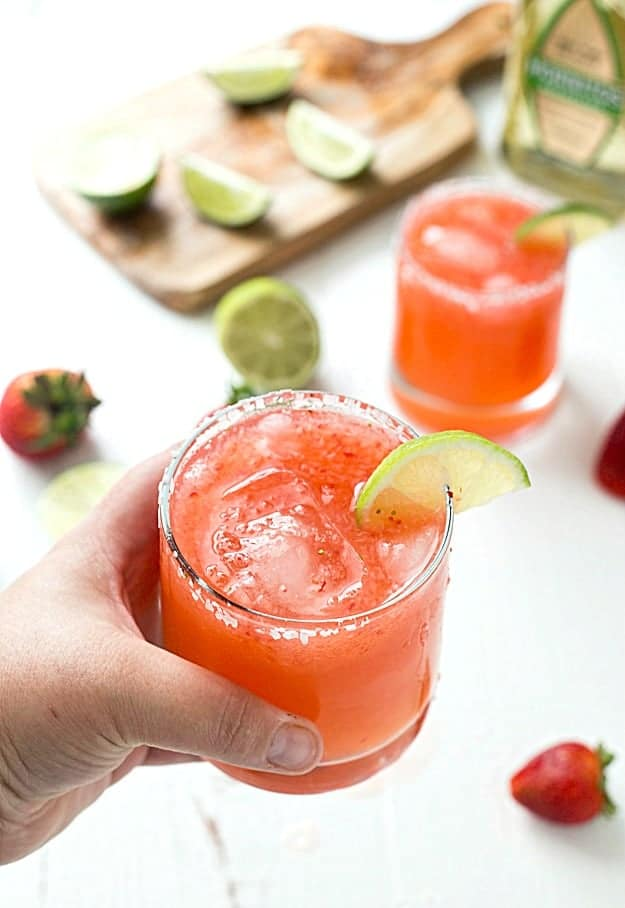 Strawberry Limeade Margaritas - Learn how to make the perfect strawberry limeade margaritas in no time! If you love classic margaritas or even frozen margaritas, you are going to love these! Sweet, tart, and refreshing!