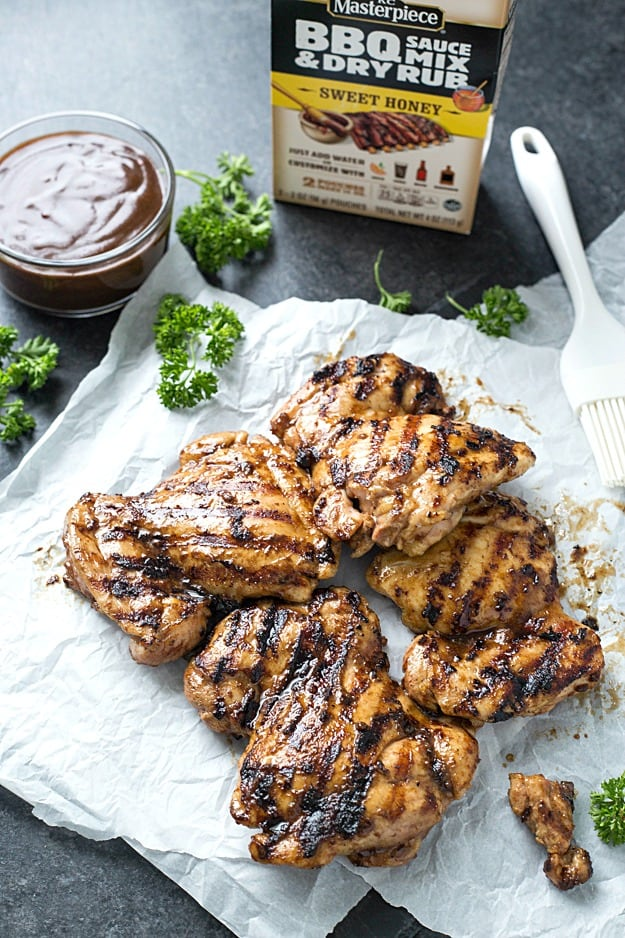 Sweet Honey BBQ Grilled Chicken - The juiciest and easiest grilled chicken thighs. Add a side for a complete meal or it instantly transforms sandwiches, salads, tacos, you name it into the most flavor bursting meal! A staple during grilling season!