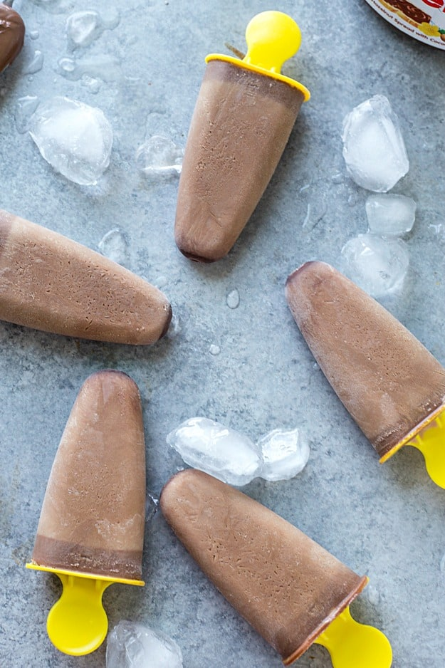 Nutella Iced Coffee Ice Popsicles Recipes - These homemade popsicles are the perfect summer treat! Takes no time to make these and they are perfect for kids and adults! So easy to swap out regular coffee for decaf. A must-have treat for when it's hot outside.