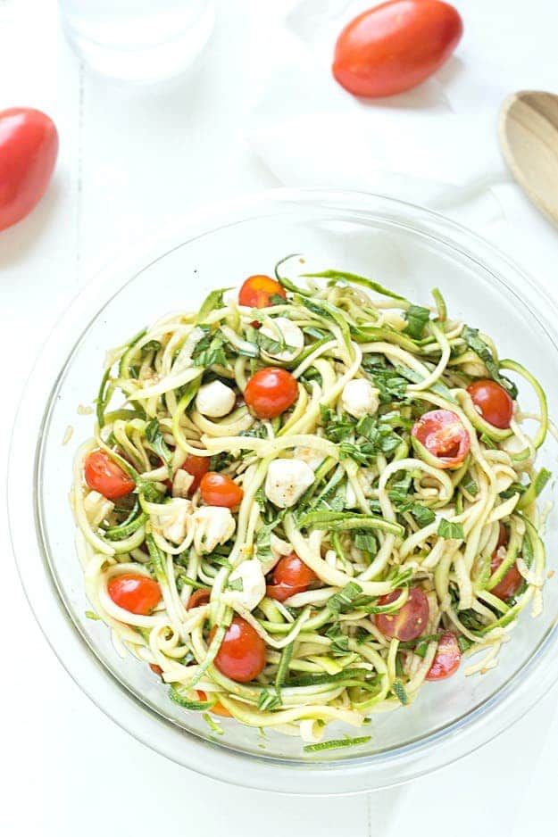 "Simple Caprese Zucchini Summer ""Pasta"" Salad - This Caprese pasta salad couldn't be any easier! The perfect summer salad and great as an appetizer or a side salad. Take it to your next potluck or BBQ and wow your guests! Low carb and keto-friendly!"