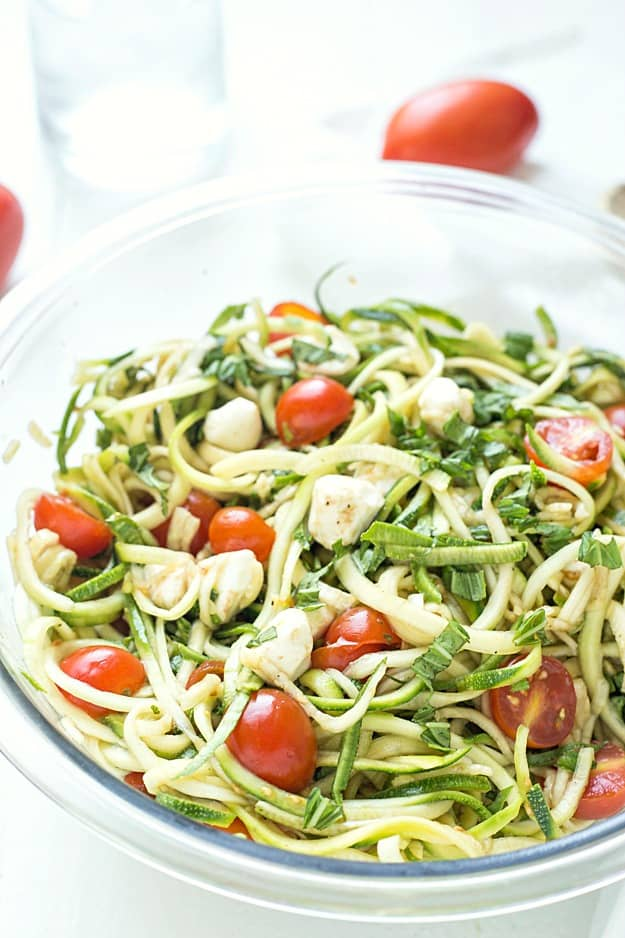"""Simple Caprese Zucchini Summer """"Pasta"""" Salad - This Caprese pasta salad couldn't be any easier! The perfect summer salad and great as an appetizer or a side salad. Take it to your next potluck or BBQ and wow your guests! Low carb and keto-friendly!"""