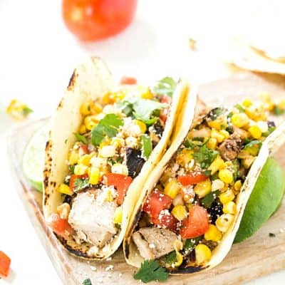 Grilled Pork Tacos with Mexican Corn Salsa - Pork tenderloin marinated to perfect and smothered with an incredible Mexican corn salsa. The corn salsa is so good you may even spoon it directly into your mouth! Everyday of the week easy!