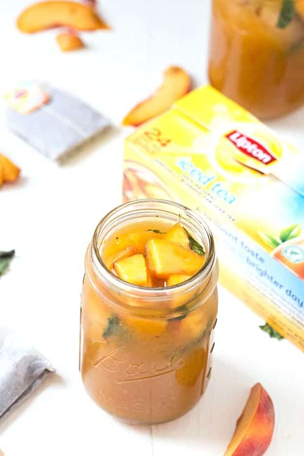Peach and Mint Iced Tea - There's nothing like a glass of homemade ice tea! The base of this refreshing ice tea is a syrup made from fresh in-season peaches, strained, and then mixed into fresh-brewed ice tea. Don't forget to muddle the mint for an extra explosion of flavor!