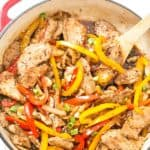 Quick and Easy Pork Stir Fry - Tender slices of marinated pork sauteed with colorful bell peppers, mushrooms, and onions, then coated in a quick and easy homemade sauce! Ready and on the table in under 30 minutes!