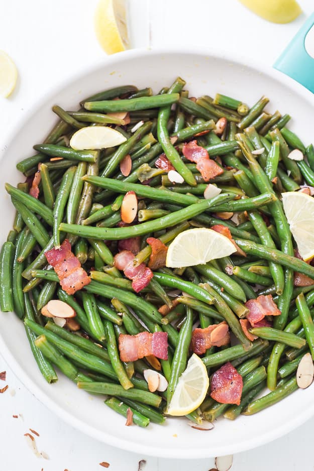 Lemon Butter Green Beans with Toasted Almonds Bacon & Feta - Fresh green beans coated in the most outrageous lemon butter sauce! They are salty, tangy, crunchy, and crispy! AKA the best green beans ever!