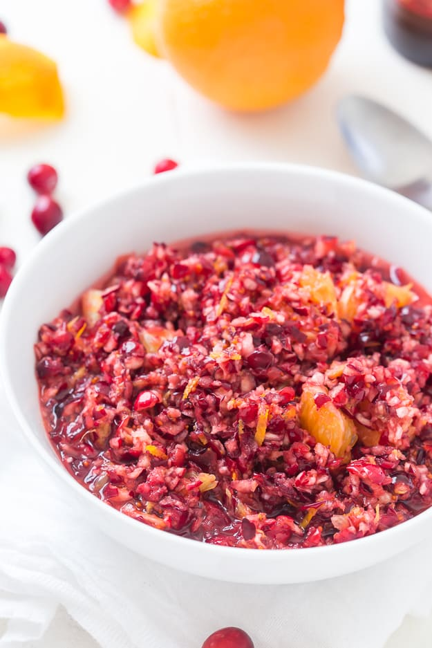 This sweet, but tart Cranberry Orange Relish Recipe is so easy and perfect for the holidays! Take a break from your traditionally served cranberry sauce and make this fresh relish instead.