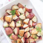 These easy Garlic Roasted Red Potatoes are full of flavor! They are crispy on the outside and oh, so tender on the inside - my favorite. Oven-roasted potatoes are a must-have for any meal!