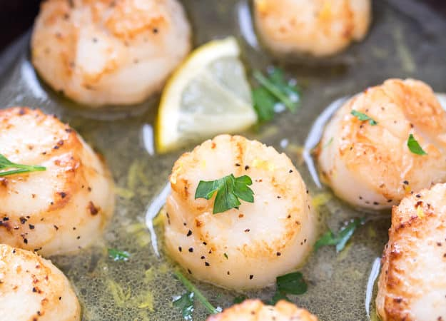 Lemon Garlic Scallops with Black Truffle Sea Salt are seared to perfection! These are the easiest and tastiest scallops you will ever make. Make restaurant-quality scallops in your own kitchen!