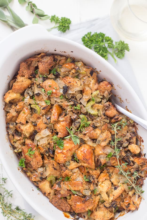 This Life-Changing Easy Thanksgiving Stuffing is my go-to stuffing recipe! Homemade stuffing is the best when made with fresh herbs, torn-apart bread, and mushrooms! A must-have this holiday!
