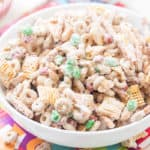 Christmas Crack Chex Mix is a family-favorite filled with Chex mix, cheerios, salted peanuts, M&M's, pretzels, and coated in chocolate! Beware because it's highly addictive and so good! Makes for delicious homemade gifts!