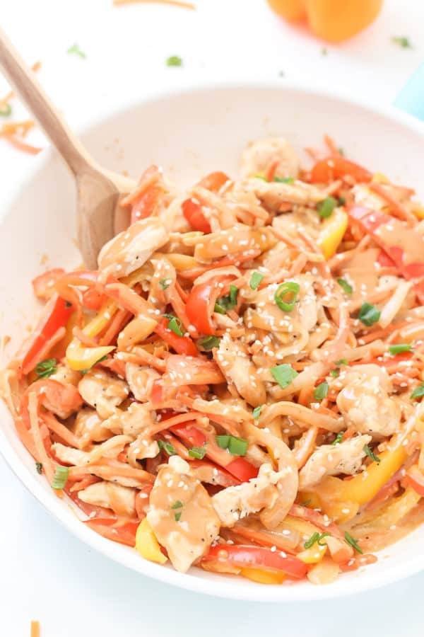 Skip the take-out and make this incredibly Easy Healthy Chicken Satay Stir Fry instead! Make it lighter with zucchini noodles or cauliflower rice!