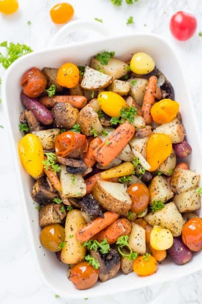 Easy Italian Roasted Vegetables are bursting with flavor from potatoes, carrots, tomatoes, and garlic. You will want to make these oven roasted vegetables with all of your meals!