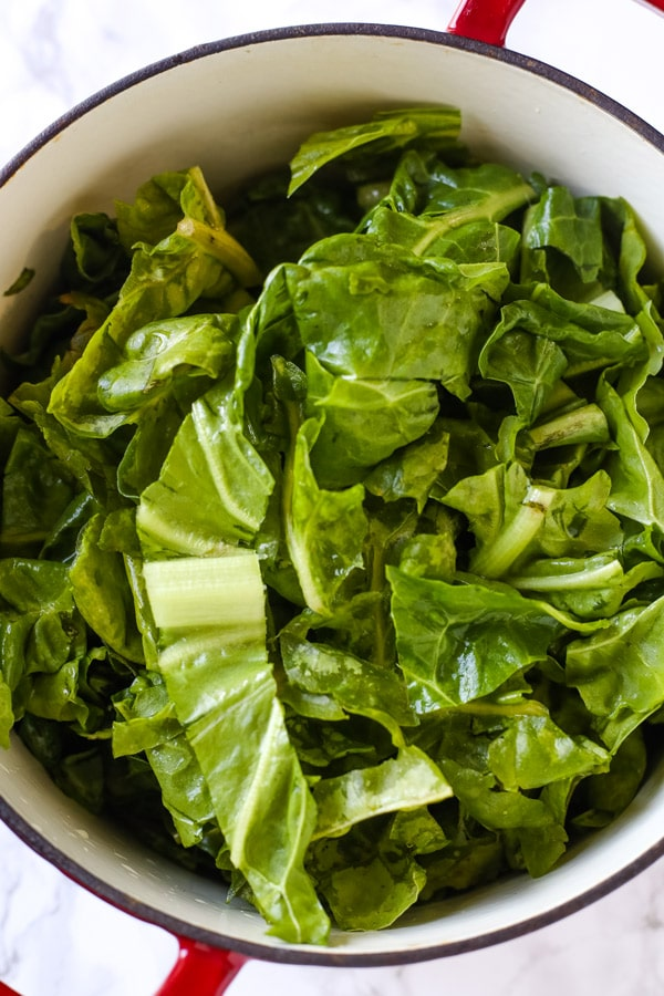 collard greens chopped in a dutch oven